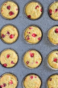 Paleo cranberry orange muffins baked in muffin pan.