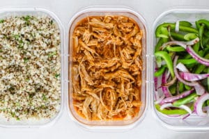 Instant pot burrito bowl ingredients divided into meal prep containers