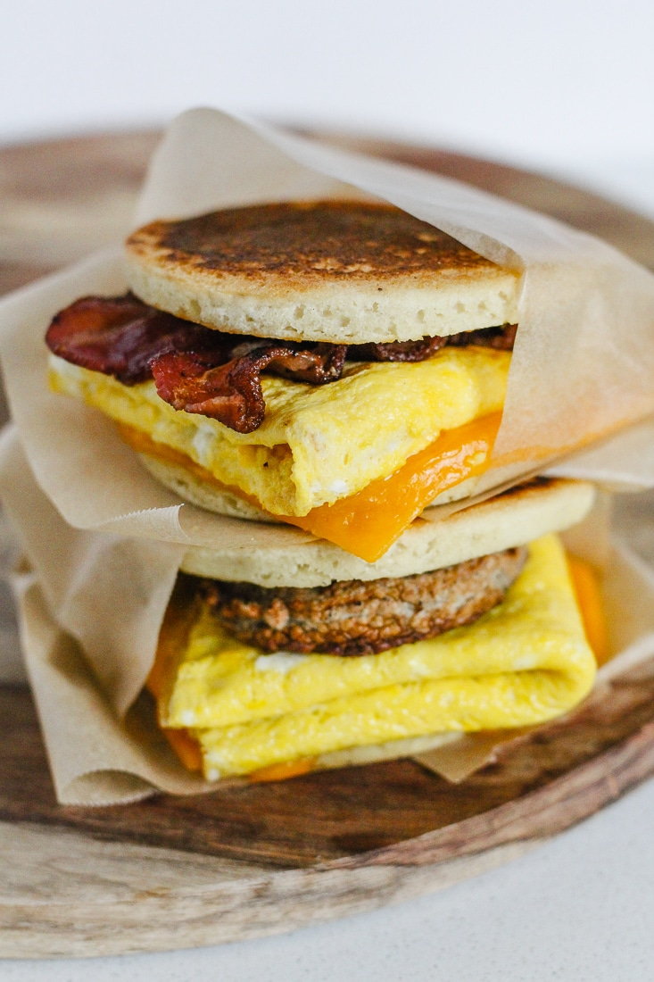 A bacon egg and cheese healthy McGriddle stacked on top of a sausage egg and cheese healthy McGriddle