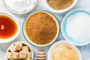 refined and unrefined sugar sources on marble table