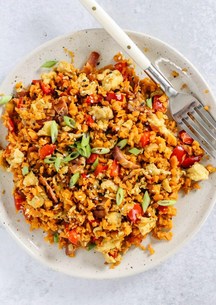 Breakfast fried sweet potato rice on a plate, birds eye view.