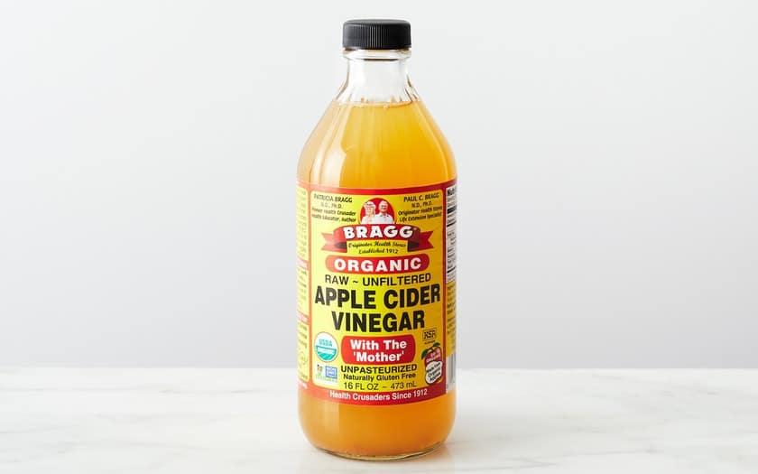 bottle of Bragg's apple cider vinegar on a table