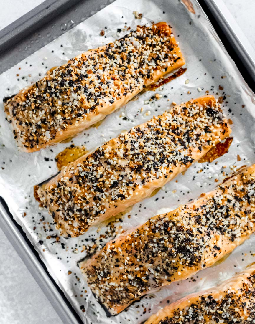 Everything bagel salmon on a foil-lined baking sheet.